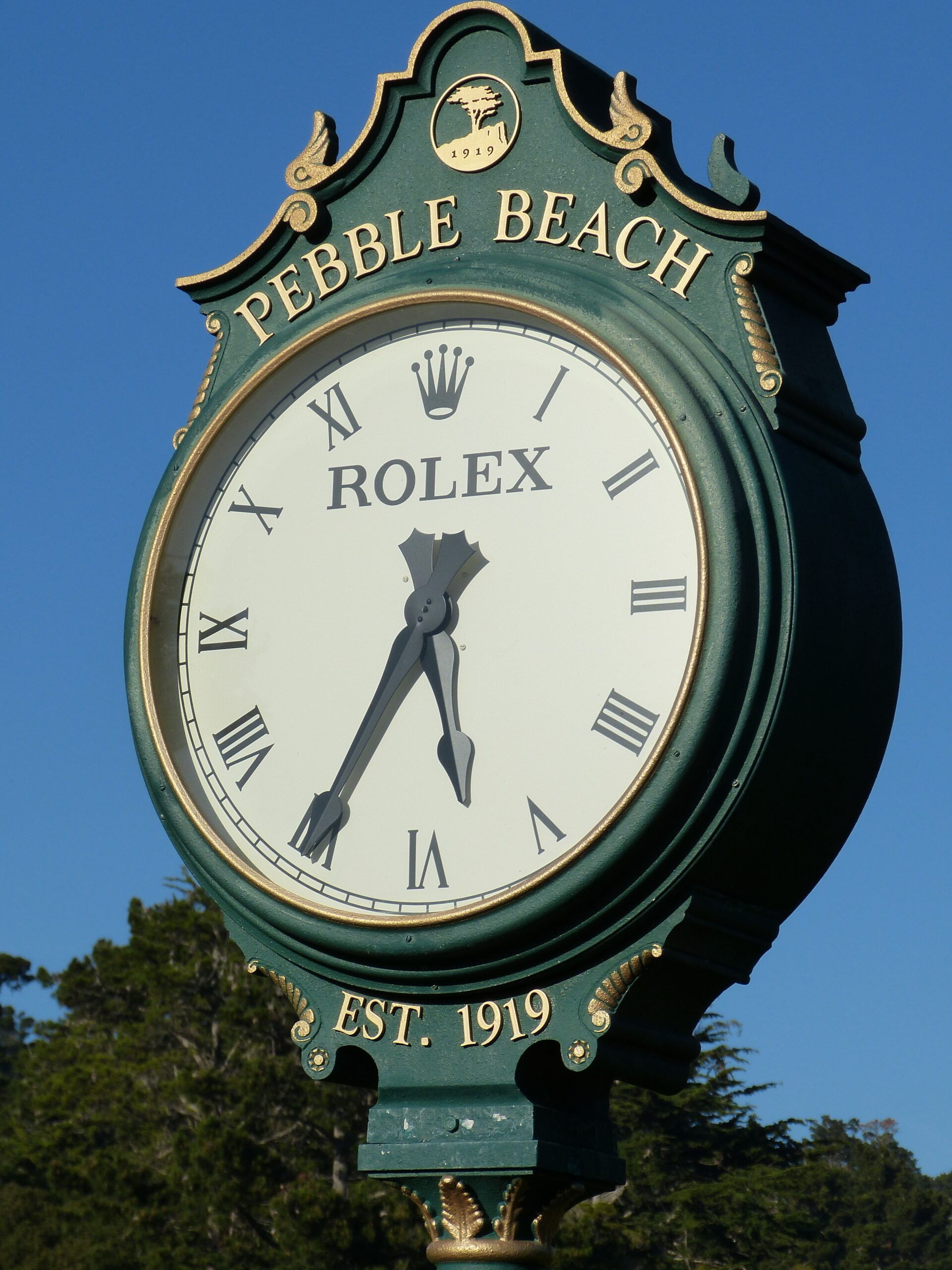 round white and green Rolex Pebble Beach analog clock